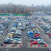 Cars parked at a park and side lot at a new entertainment center Blockbuster in Kiev.