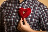 Conceptual Photo Of Man Holding Red Heart On Chest