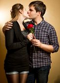 Beautiful Young Couple In Love Kissing At Studio