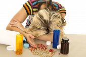 Woman Head Down Lots Of Pills