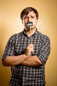 Thoughtful Hipster Guy Posing With Fake Mustache On Stick