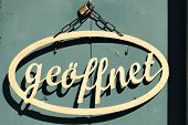 Sing On Door With Text Geoffnet