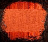 tangelo (orange) burlap textured on wood background