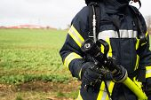 German Firefighter With Equipment