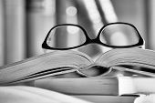 Black And White Picture Of Glasses On A Book
