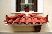 Small decorative roof below the window