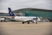 Budapest, Hungary - March 5 - Lot Embraer Erj-170 Taxiing To The Gate After Landing At Budapest, Mar