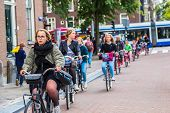 People Riding Bicycles In Amsterdam