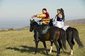 People in national dresses ride on horseback, Almaty, Kazakhstan.