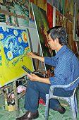Artist Paints Van Gogh Reproduction In Hcmc Art Market.