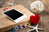 Blank Instant Photos With Red Hearts.on Wooden Background