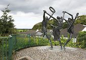 Statue of dancers at the city Cashel in Ireland.