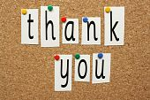 stock photo of thank you  - The phrase Thank You in cut out letters pinned to a cork notice board - JPG