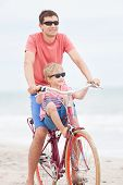 Family Biking At The Beach
