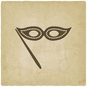 Masquerade mask symbol old background