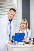 Portrait Of Two Happy Mature Doctors.