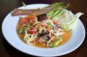 stock photo of green papaya salad  - Popular Thai spicy papaya salad or Somtam with fresh vegetable - JPG