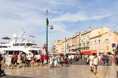Tourists walking in the old port of Saint Tropez