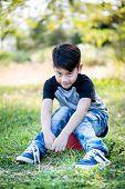 Portrait Of Asian Cute Little Boy At The Park