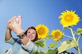 Happy Asian Woman In Sunflower Flower Field.