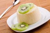 picture of panna  - Close up photograph of a sweet panna cotta with kiwifruit - JPG