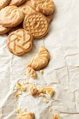 Biscuits  And Crumbs On Crumpled Paper
