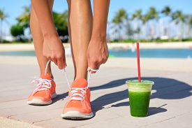 pic of smoothies  - Running woman runner with green vegetable smoothie - JPG