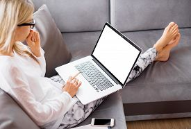 stock photo of thoughtfulness  - Busy woman working with laptop computer at home - JPG