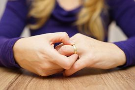 picture of split ends  - woman is taking off the wedding ring - JPG