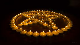 foto of wicca  - Many burning candles arranged into the shape of a pentagram - JPG