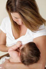 picture of lactating  - Mother breastfeeding nursing her newborn baby - JPG