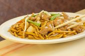 pic of chinese wok  - Authentic Chinese chicken lo mein noodles at a restaurant - JPG