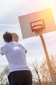 picture of early 20s  - Young man shooting free throws from the foul line - JPG