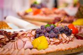 foto of smoked ham  - Choice of smoked ham and sausages on the table - JPG
