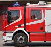 stock photo of fire brigade  - new red fire trucks with sirens blue ready for emergency - JPG