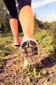 stock photo of exercise  - Walking or running exercise legs on footpath in forest motivation inspiration concept outdoors achievement fitness adventure and exercising in spring or summer nature - JPG