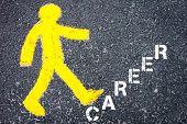 stock photo of pedestrians  - Yellow pedestrian figure on the road walking towards CAREER - JPG