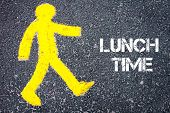 stock photo of pedestrians  - Yellow pedestrian figure on the road walking towards LUNCH TIME - JPG