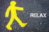 foto of pedestrians  - Yellow pedestrian figure on the road walking towards RELAX - JPG