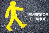 foto of pedestrians  - Yellow pedestrian figure on the road walking towards EMBRACE CHANGE - JPG