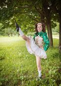 picture of wig  - Young beautiful girl in irish dance dress and wig dancing outdoor - JPG