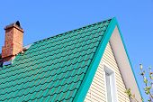 picture of roof tile  - Mint color tiled roof and brick chimney taken closeup - JPG
