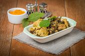 stock photo of curry chicken  - stew chicken in curry with mushrooms on wooden table - JPG