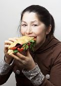 picture of tomato sandwich  - Woman with a sandwich with tomatoes - JPG