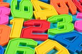 stock photo of blue things  - Colorful plastic numbers 123 close up on a blue background - JPG