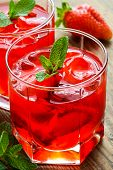 picture of cold drink  - Cold strawberry drink with strawberry slices and mint - JPG
