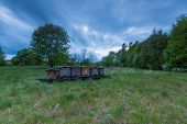 foto of honey bee hive  - Bee hives on trail in rural landscape - JPG