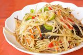 picture of green papaya salad  - Papaya salad sliced green papaya mixed with condiments Thai local food - JPG