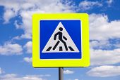 pic of pedestrian crossing  - Traffic sign pedestrian crossing with clouds in background - JPG