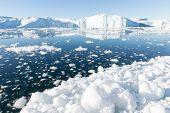 foto of iceberg  - Beautiful Icebergs in Disko Bay Greenland around Ilulissat with blue sky - JPG